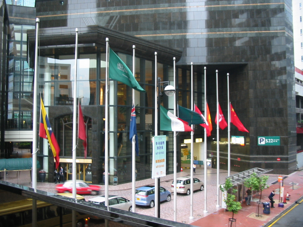 Image of a group of national flags flown at half-staff.