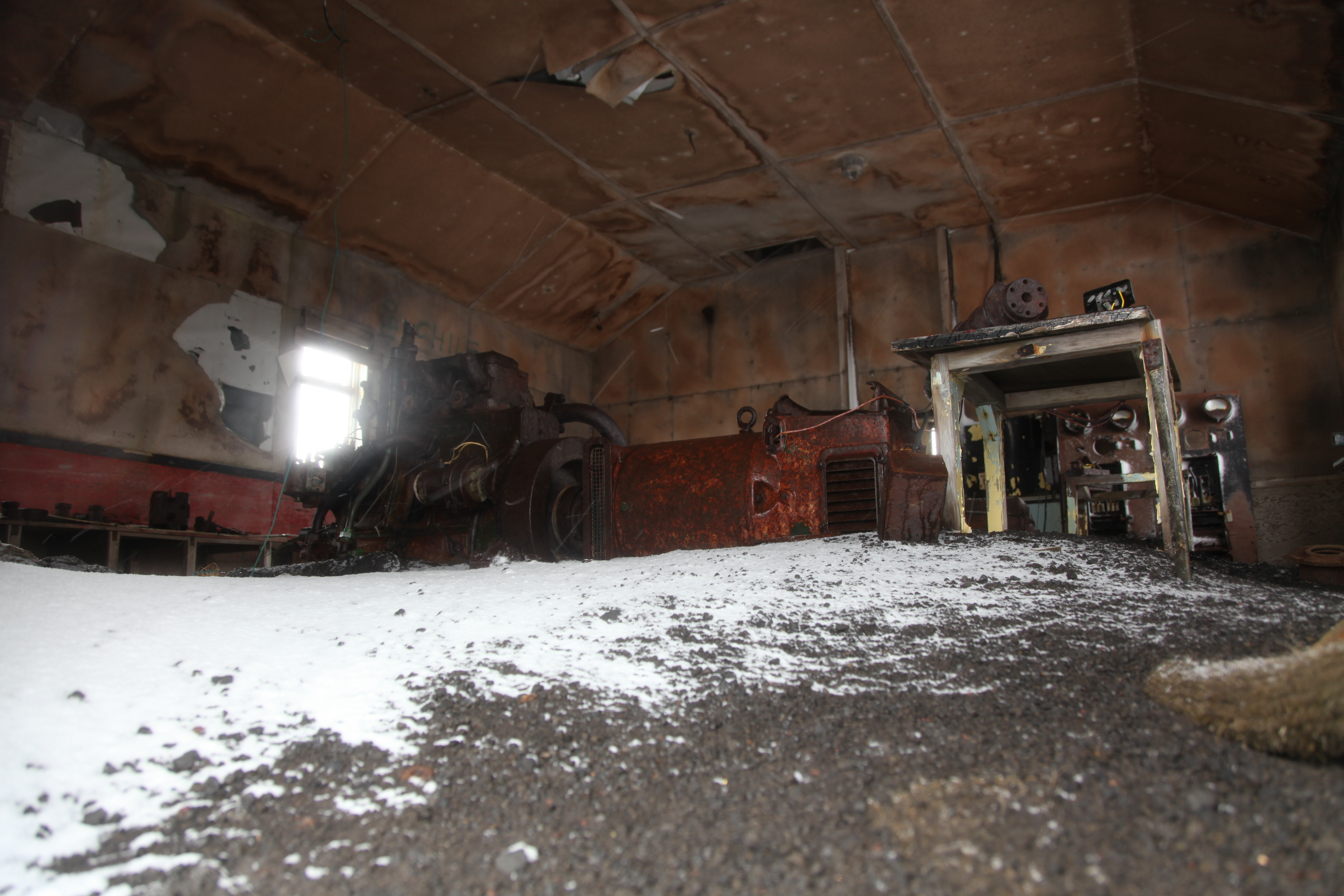 S 60 >> File:Looking inside the abandoned research base at Whalers Bay, Deception Island (6023707835 ...