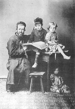 A Jewish father teaching a child in 19th centu...
