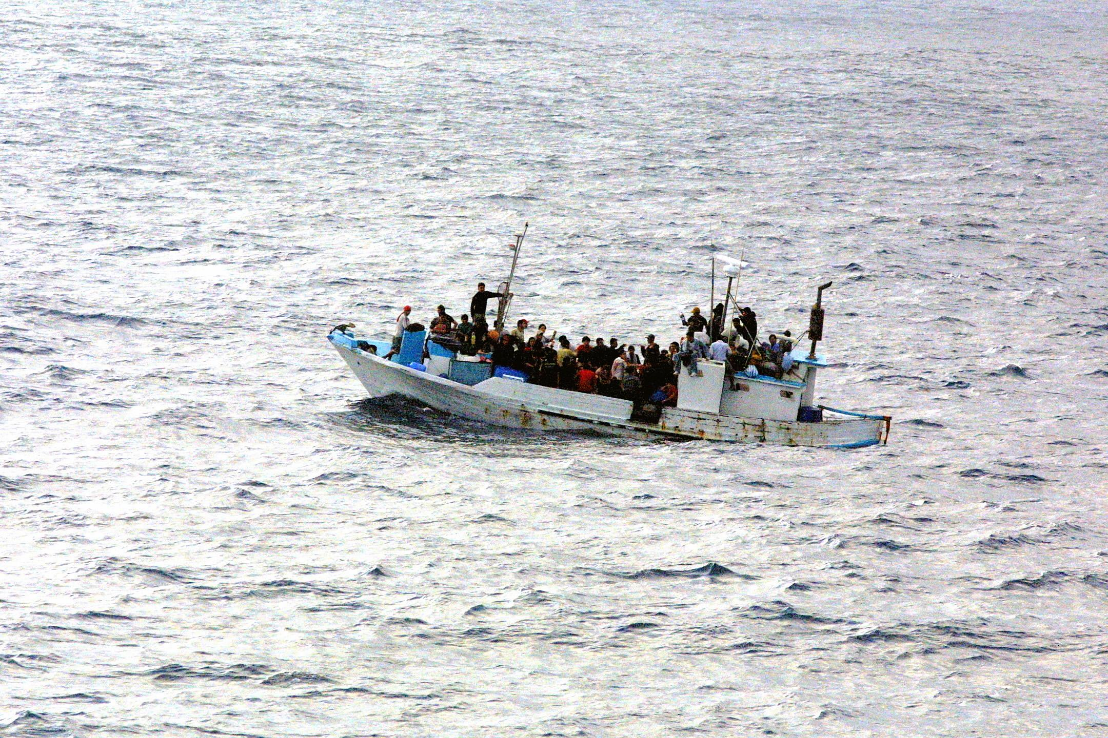 [Image: Refugees_on_a_boat.jpg]