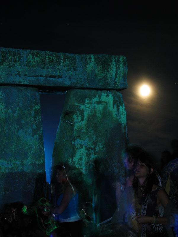 Dancing around a Stonehenge dolmen at Summer solstice