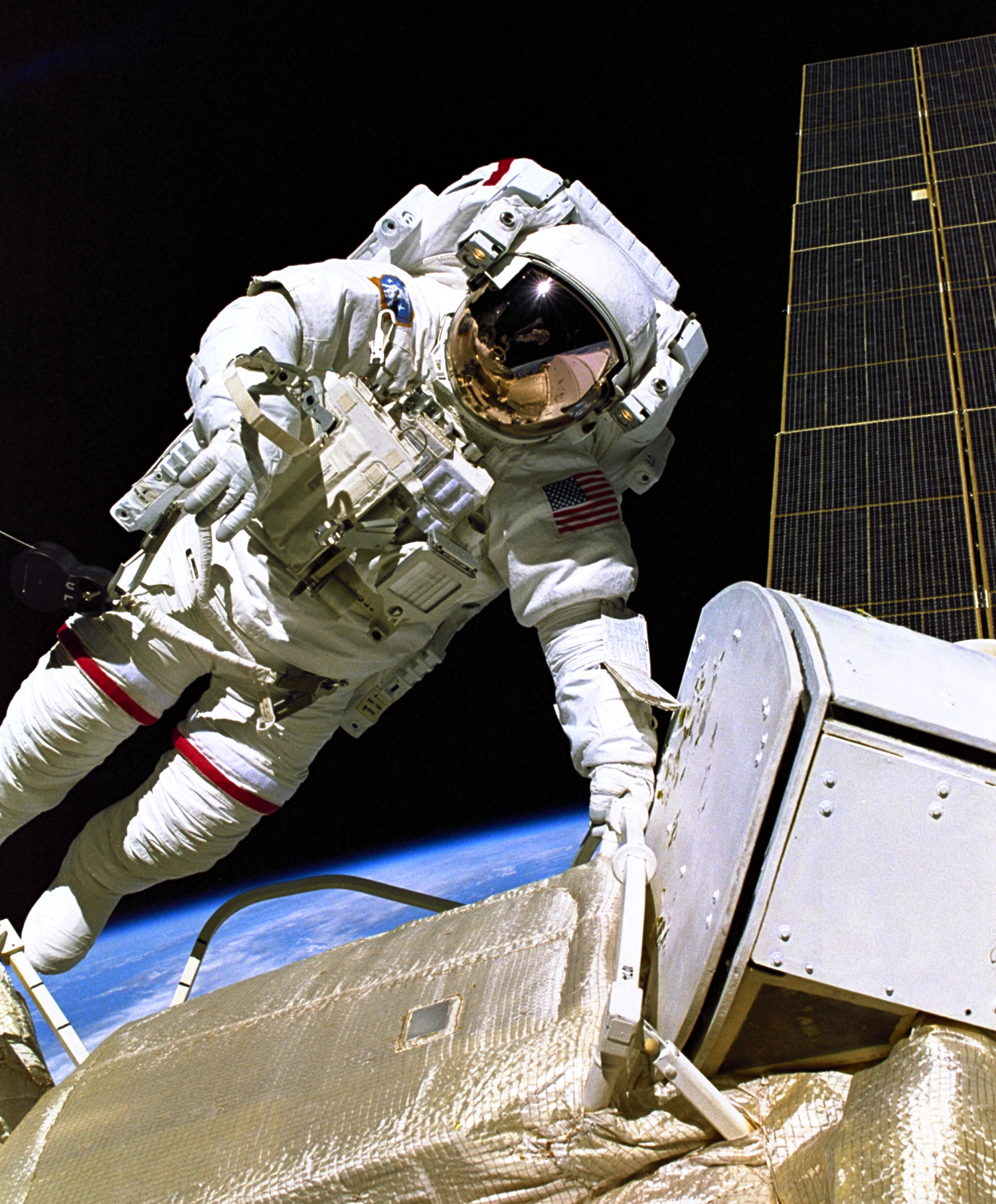 Astronaut Jerry L. Ross, STS-88 mission specialist, is ...