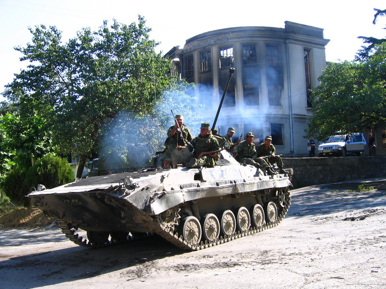 Tank-like vehicle with soldiers aboard