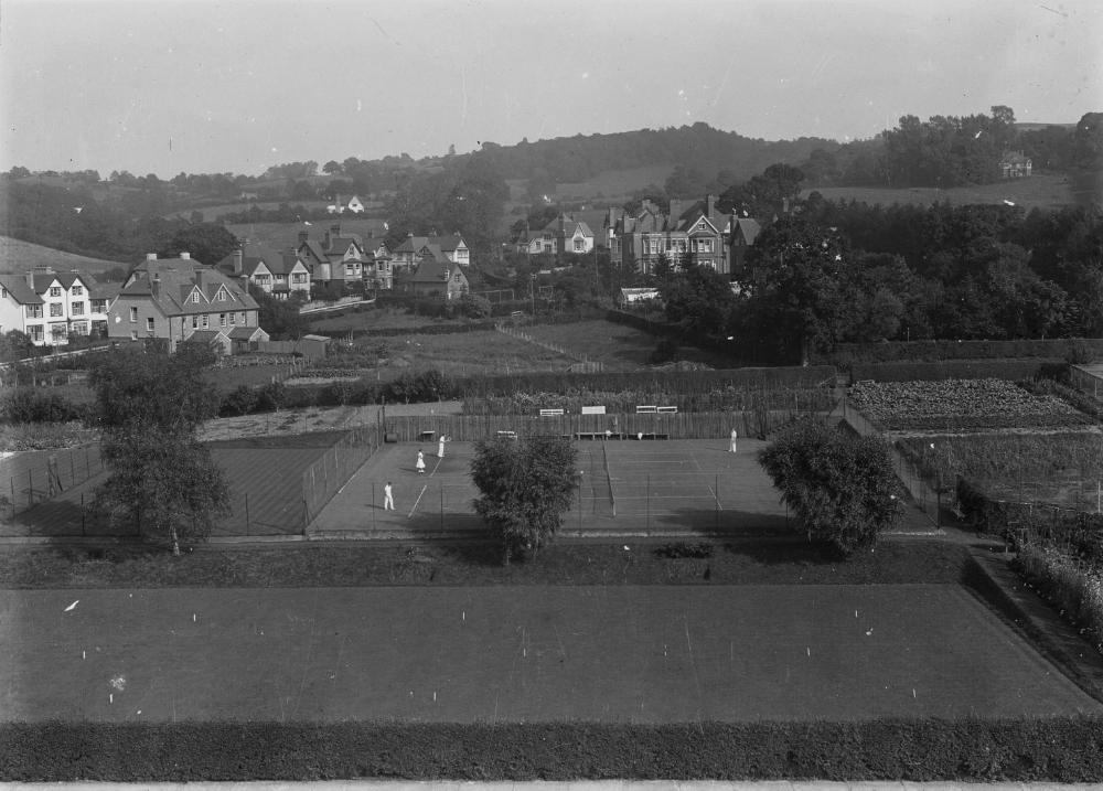 View of unidentified village with tennis courts and allotments