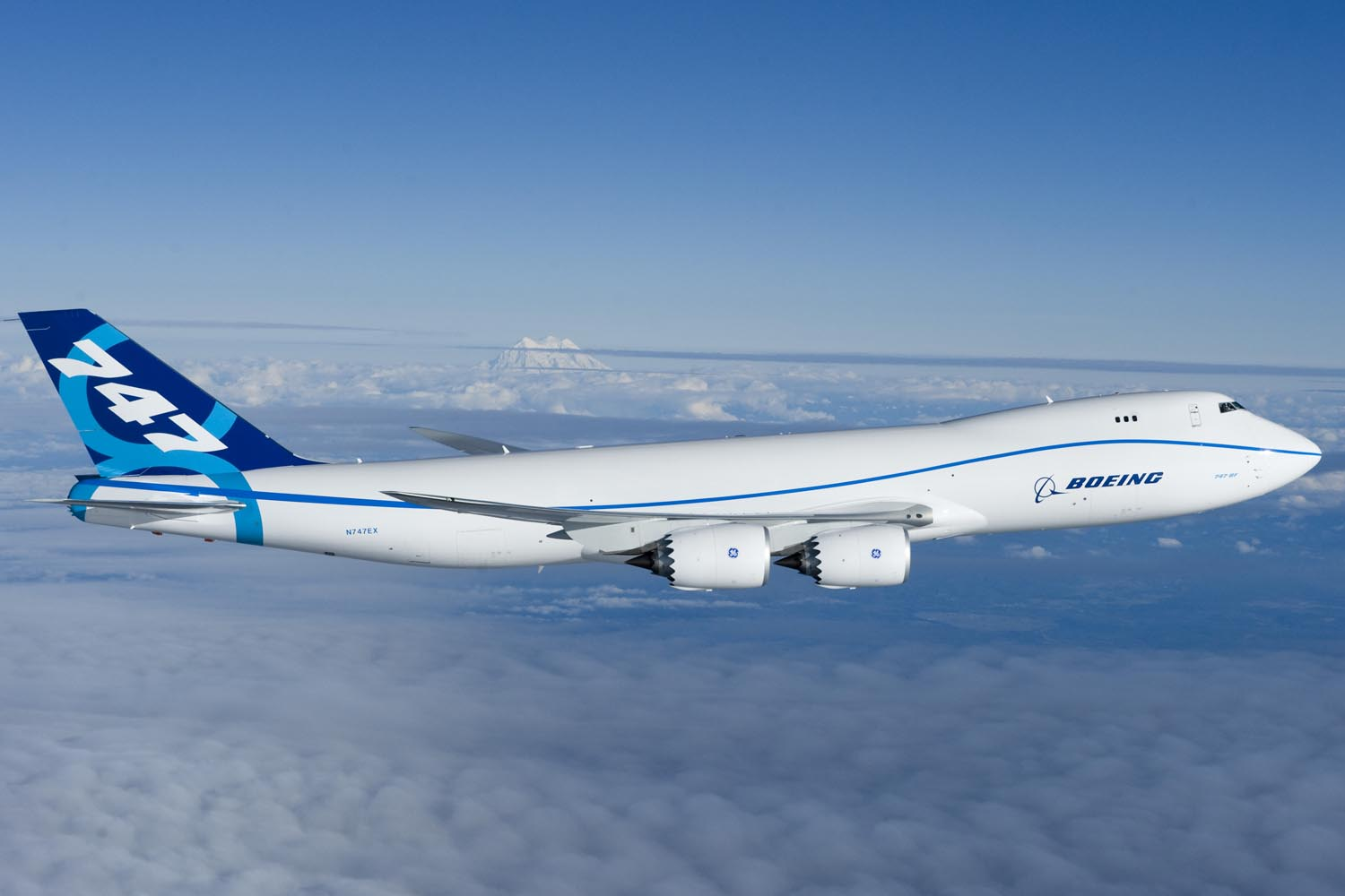 Side view of quadjet over clouds