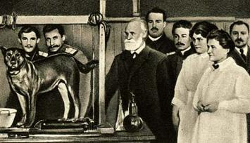 Pavlov and colleagues are seen next to a dog experimental subject