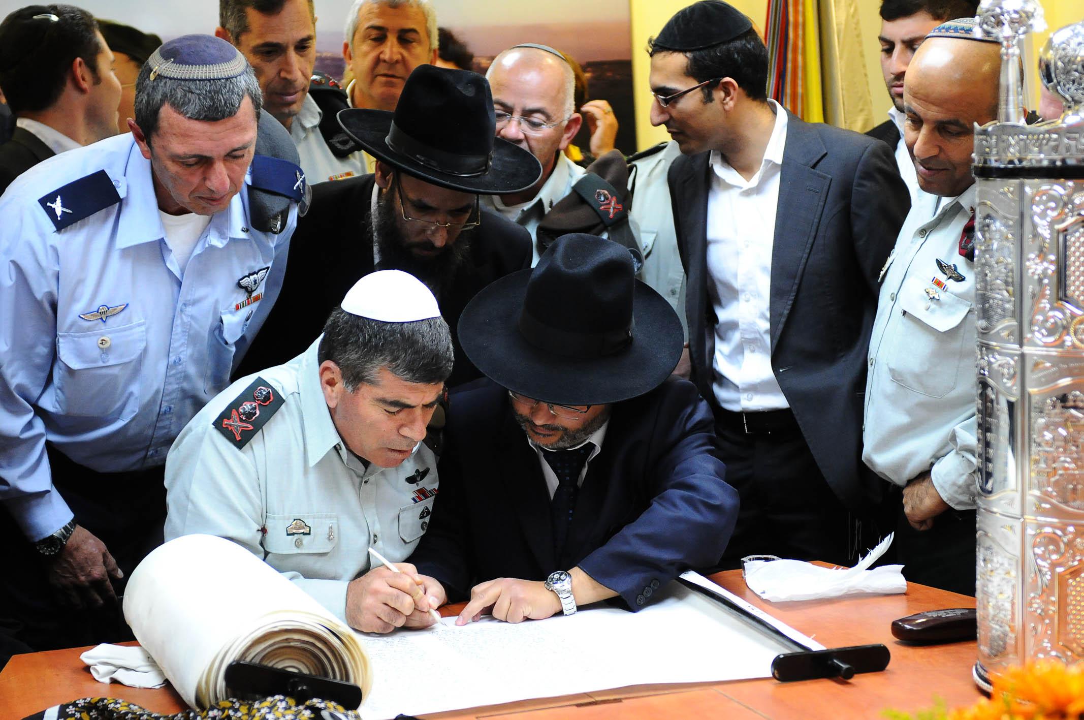 Torah emerges under devoted hand