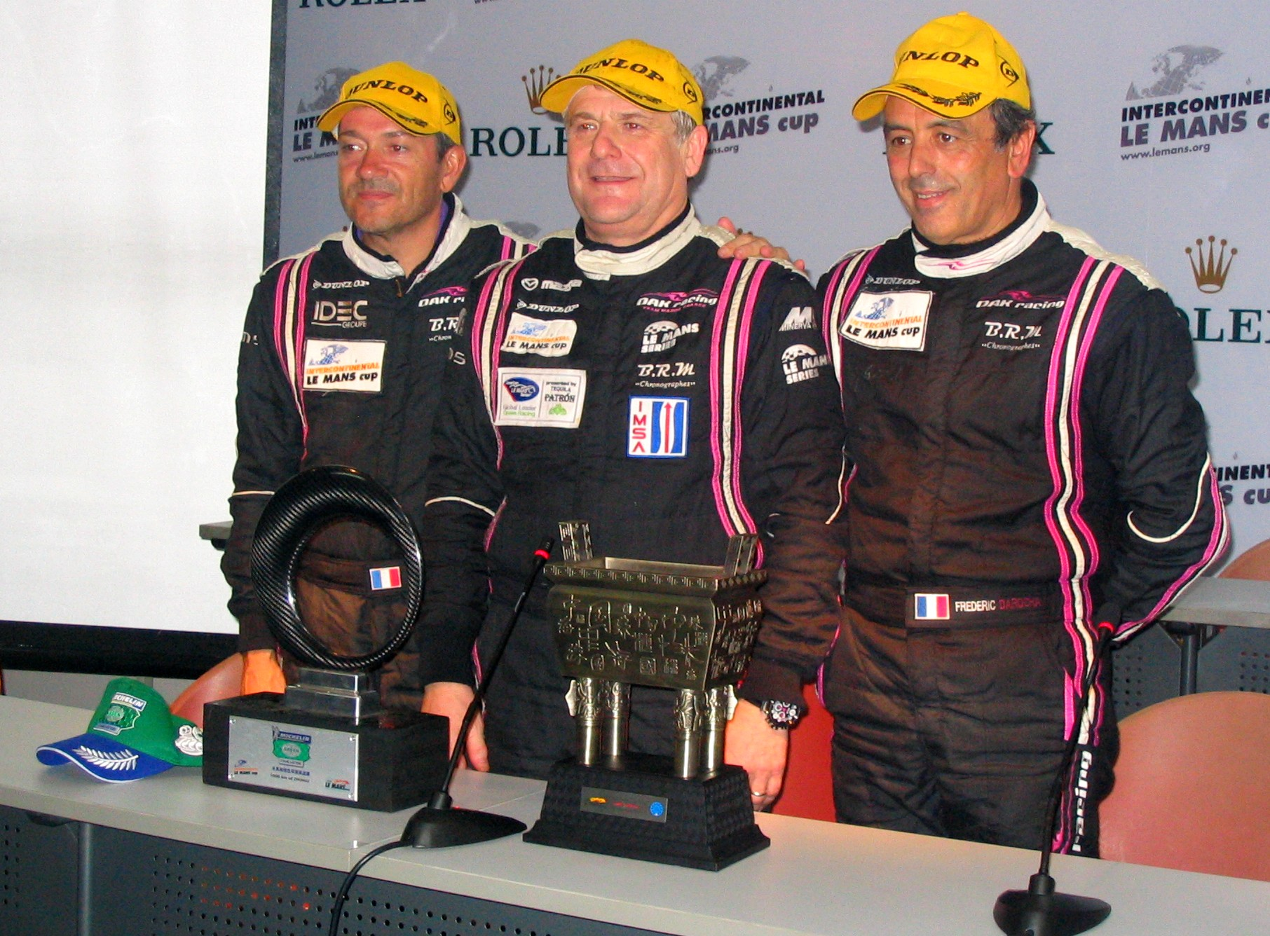 Nicolet (centre) after winning the [[2010 1000 km of Zhuhai]] with Patrice Lafargue (left) and Frédéric da Rocha.