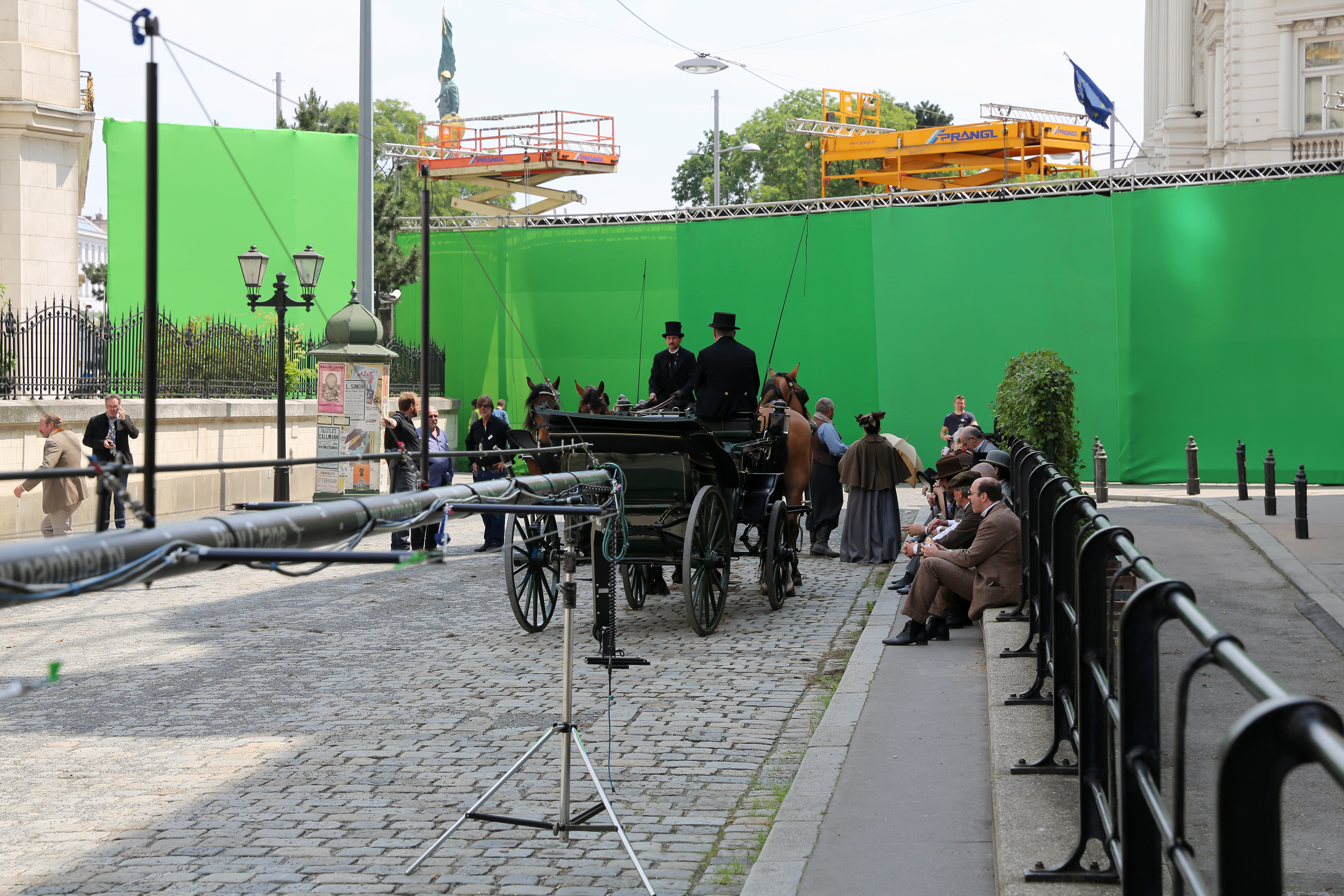 Why are movies filmed on a green background