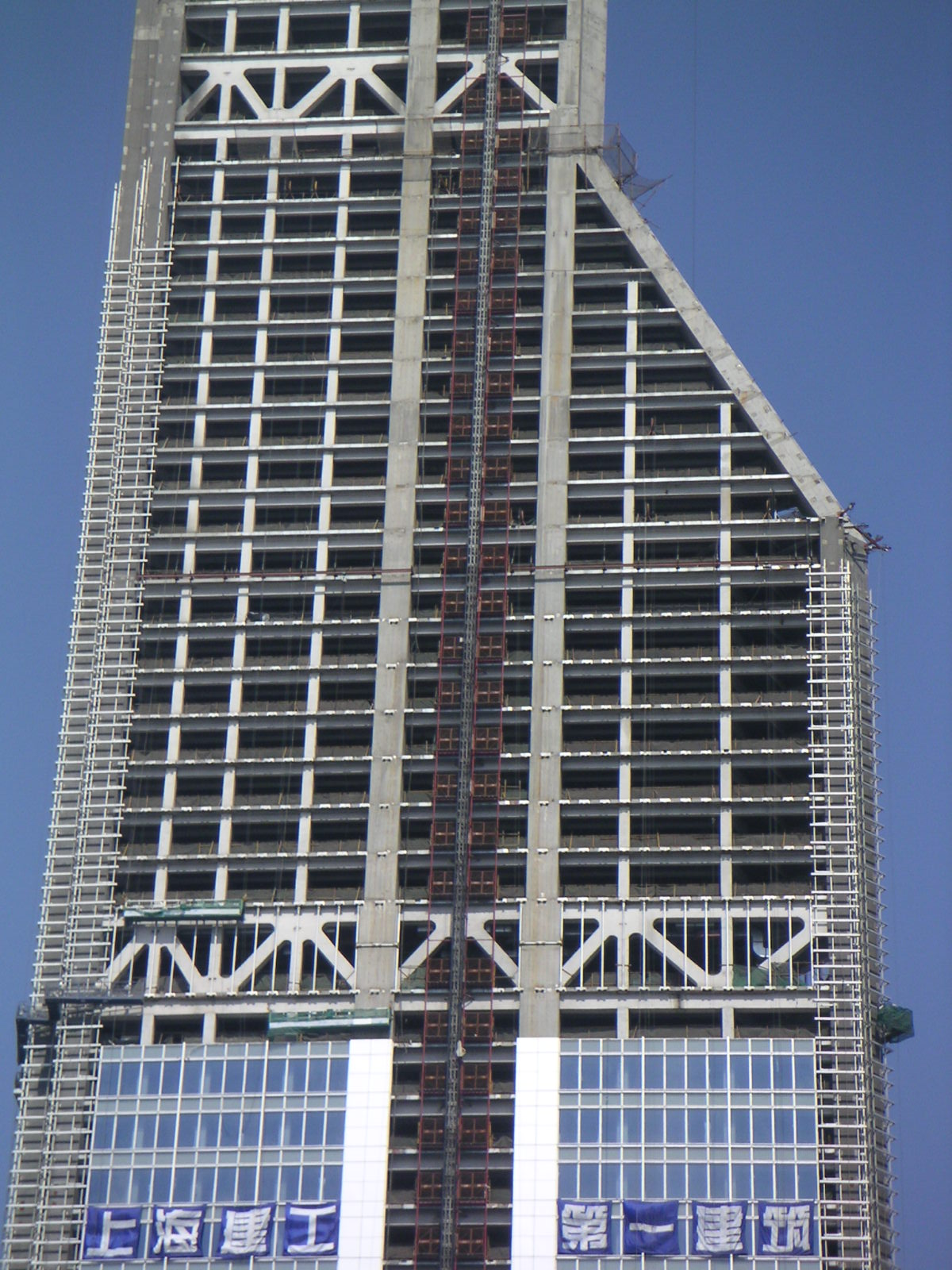 A 60-story building under construction in Shanghai. The truss sections (made of triangular struts) will house mechanical floors.