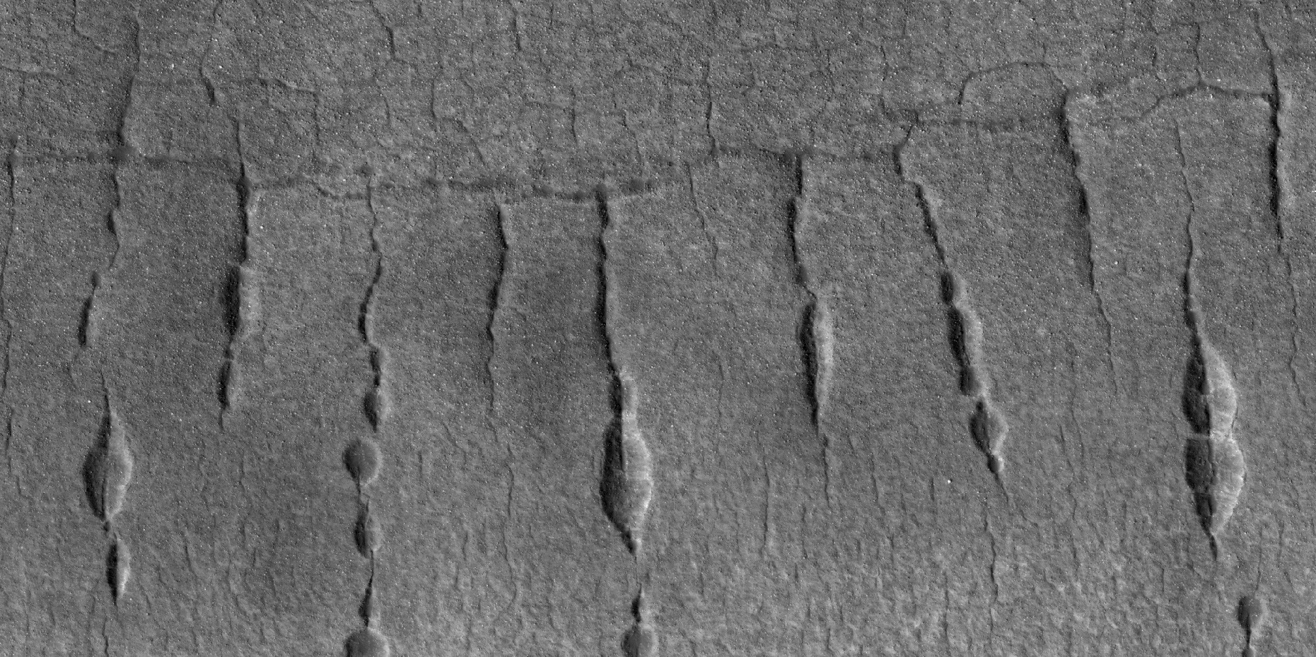 Close view of lines of pits, as seen by HiRISE under HiWish program