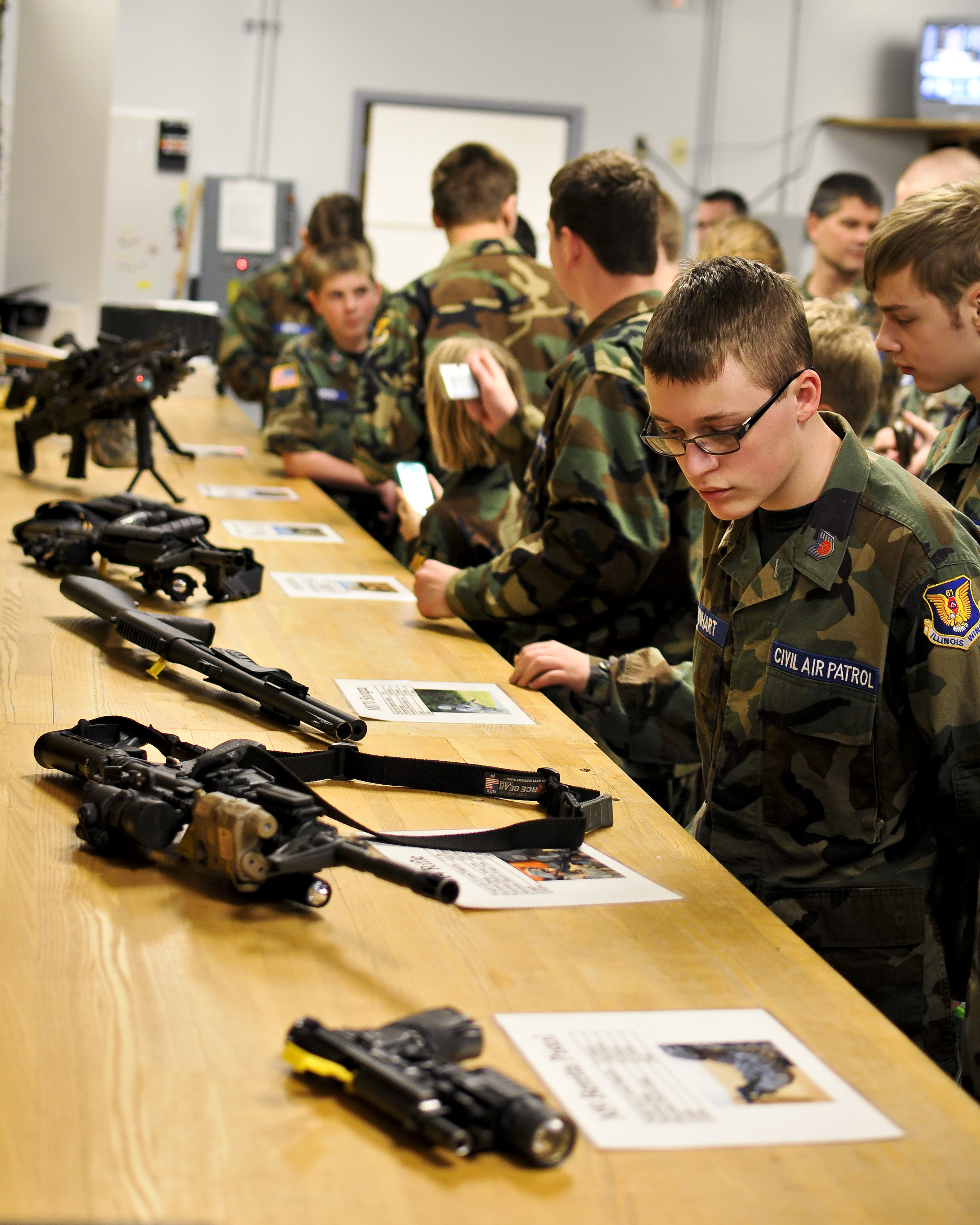 a4afc33ecb3 A Civil Air Patrol cadet reads the nomenclature of a security forces  squadron M4 carbine at the 182nd Airlift Wing.