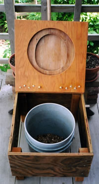 English: Lifted toilet seat reveals compost bi...