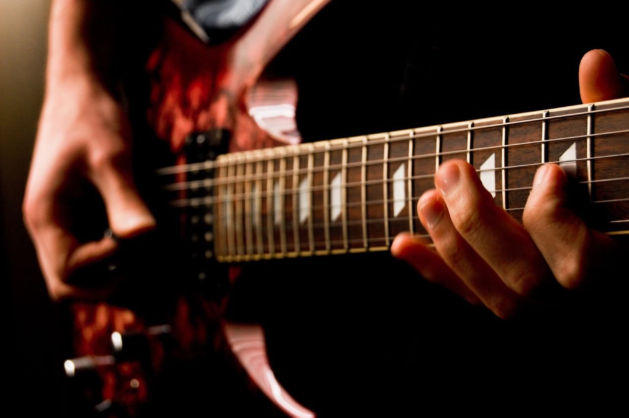 7 Reasons Why Playing Guitar Is Good For You - Unfinished Man