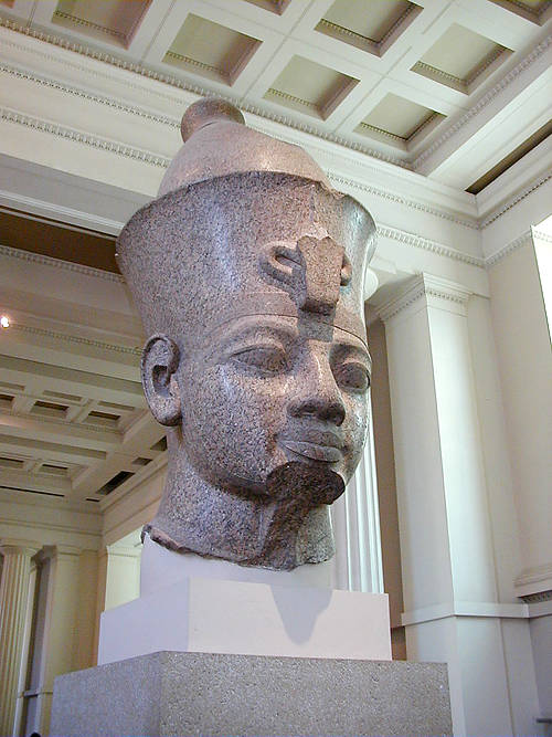 The Colossal Red Granite head of Amenhotep III