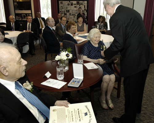 Isabella (seated center) and Jerome Karle (left foreground) at their 2009 retirement ceremony
