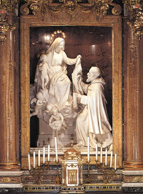Statue of the Virgin Mary giving the Scapular to St. Simon Stock (19th-century) by Alfonso Balzico located in the church of Santa Maria della Vittoria, Rome Mariascapular.jpg