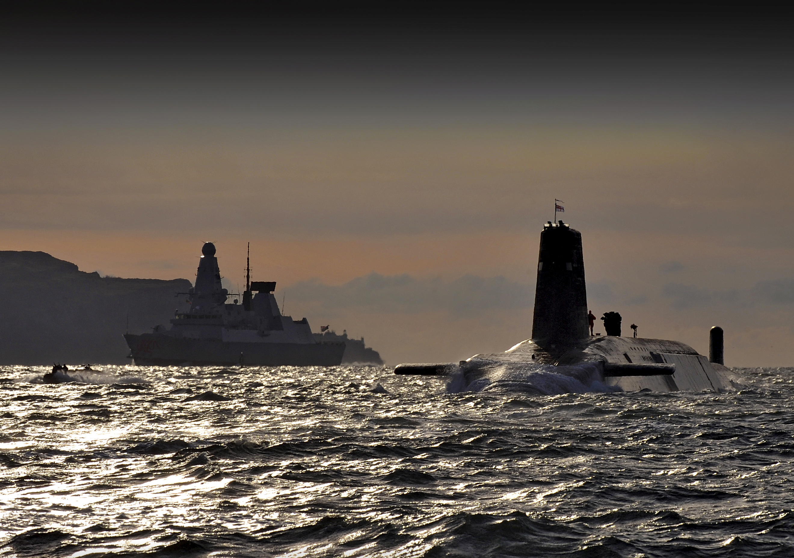 Nuclear Submarine HMS Vanguard Passes HMS Dragon as She Returns to HMNB Clyde, Scotland MOD 45152118.jpg