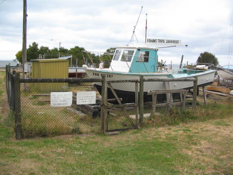 File:Boatyards, Rhyll.jpg