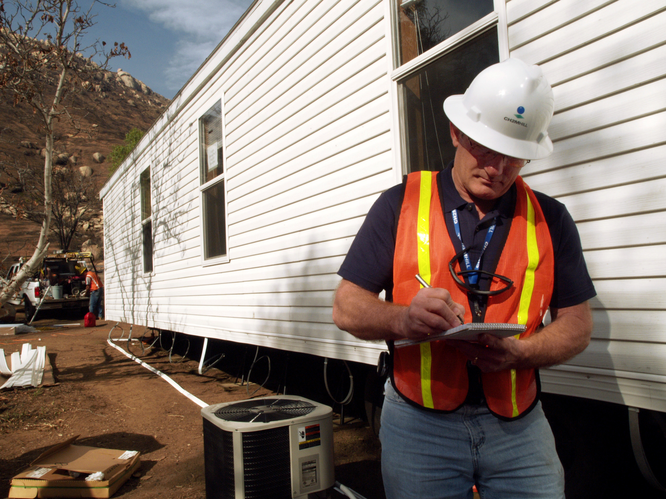 File fema 33786 fema contractor inspects a mobile home for Contractors needed to build a house