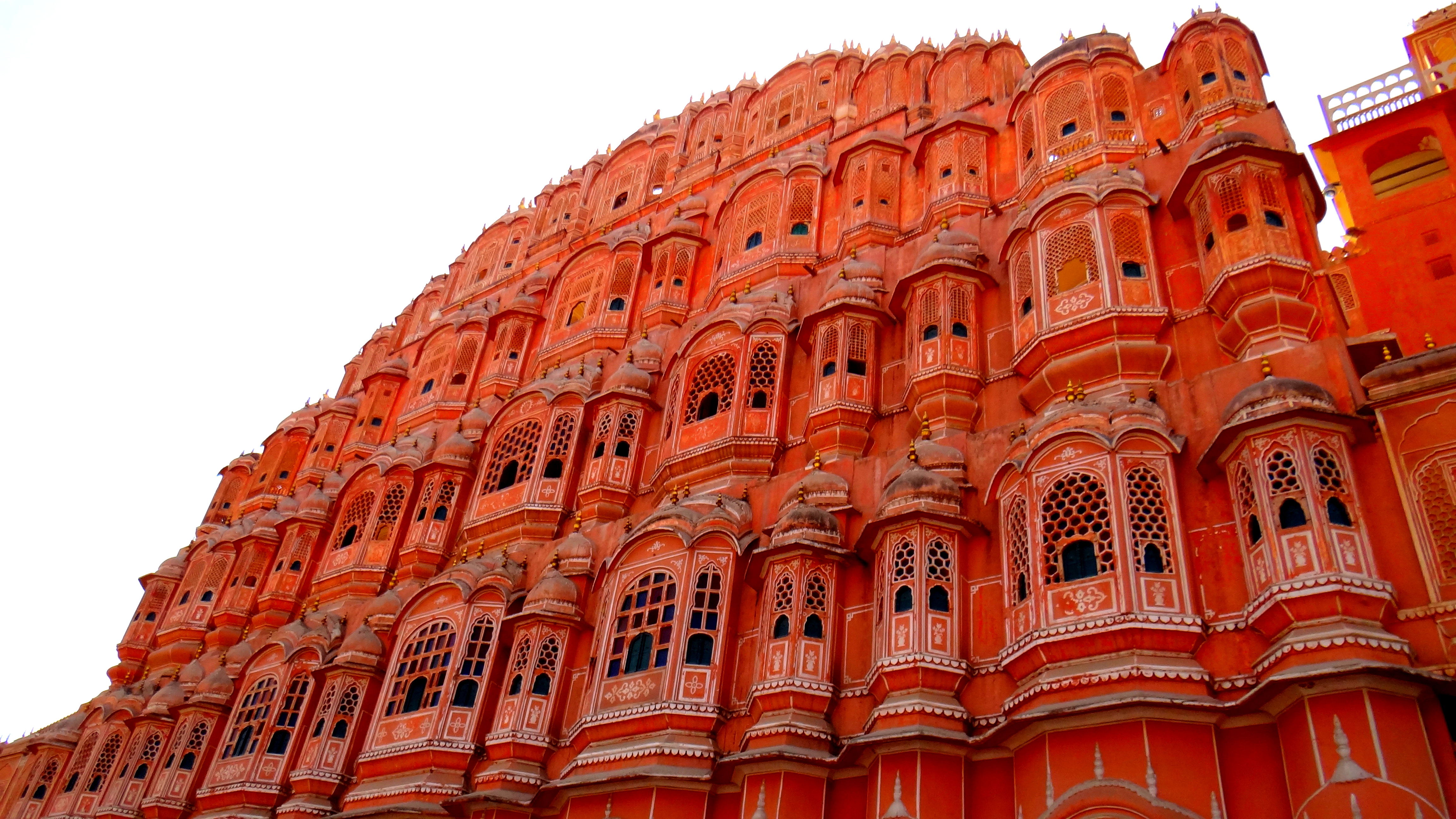 """hawa mahal Hawa mahal (hindi: म ल, translation: palace of winds or """"palace of the breeze""""), is a palace in jaipur, india it was built in 1799 by maharaja sawai pratap singh, and designed by lal chand ustad in the form of the crown of krishna, the hindugod."""