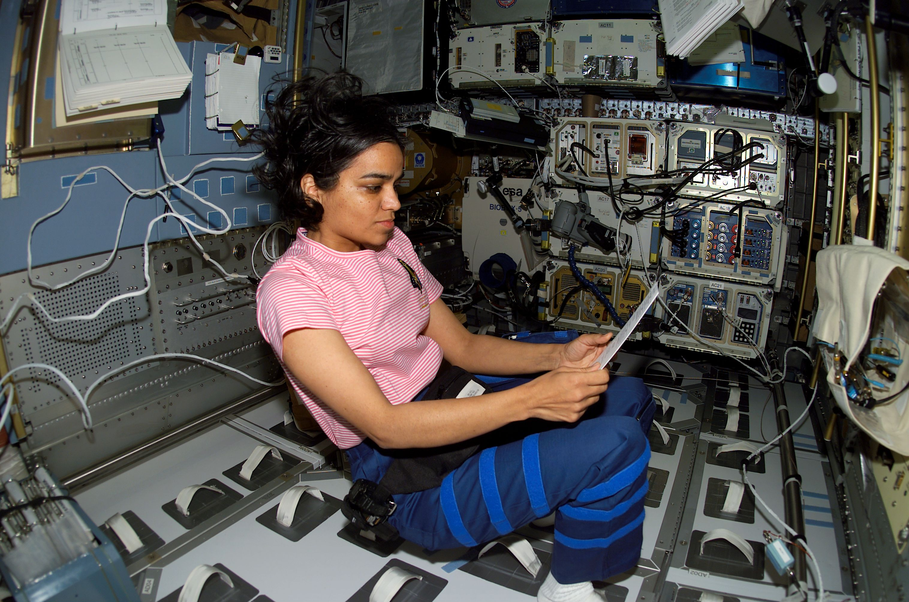 Astronaut Kalpana Chawla looks over a procedures checklist in the SPACEHAB Research Double Module aboard the Space Shuttle Columbia.