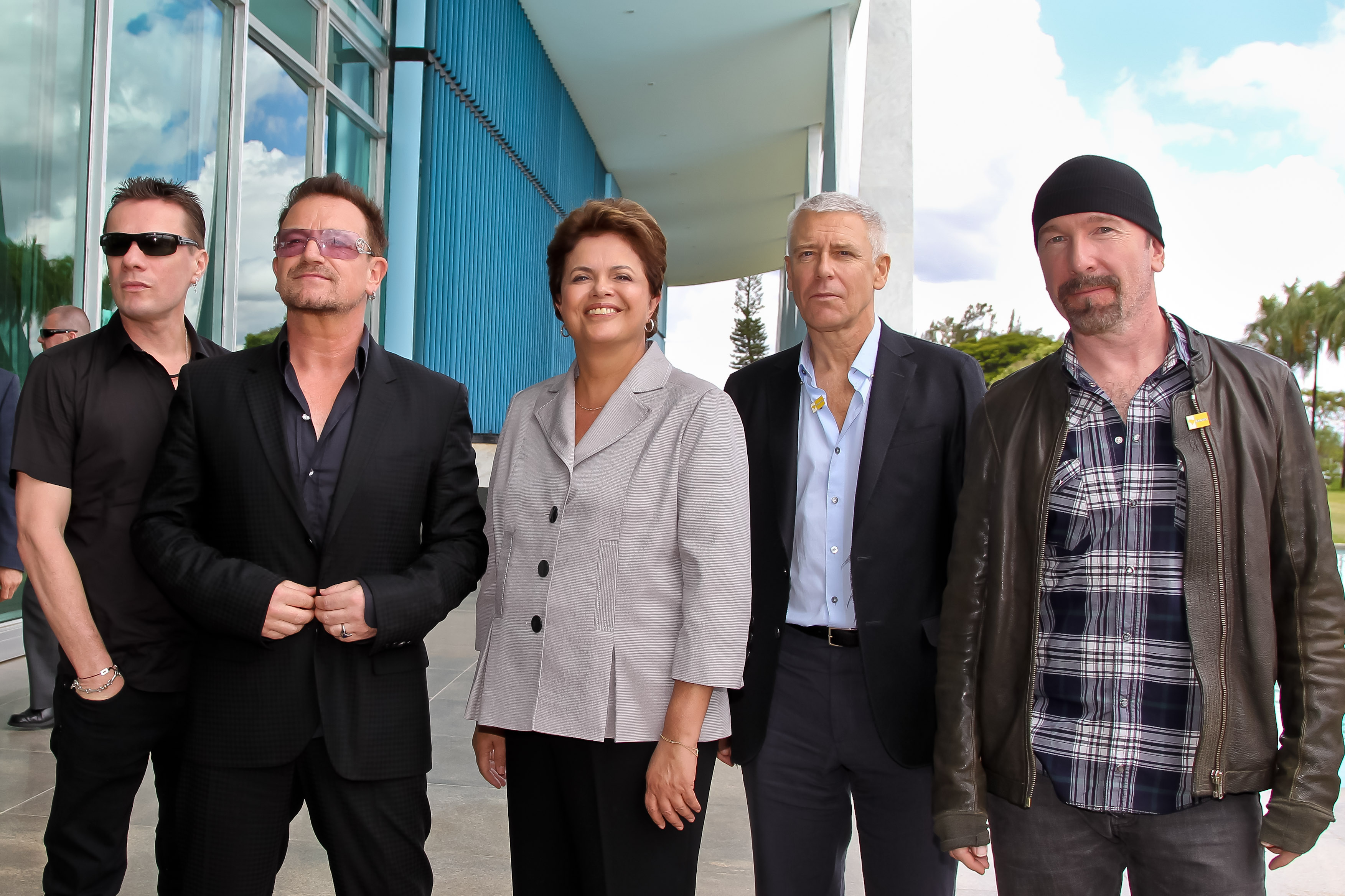 U2 with Brazilian president Dilma Rousseff in 2011 (from left to right): Mullen, Bono, Rousseff, Clayton, and the Edge