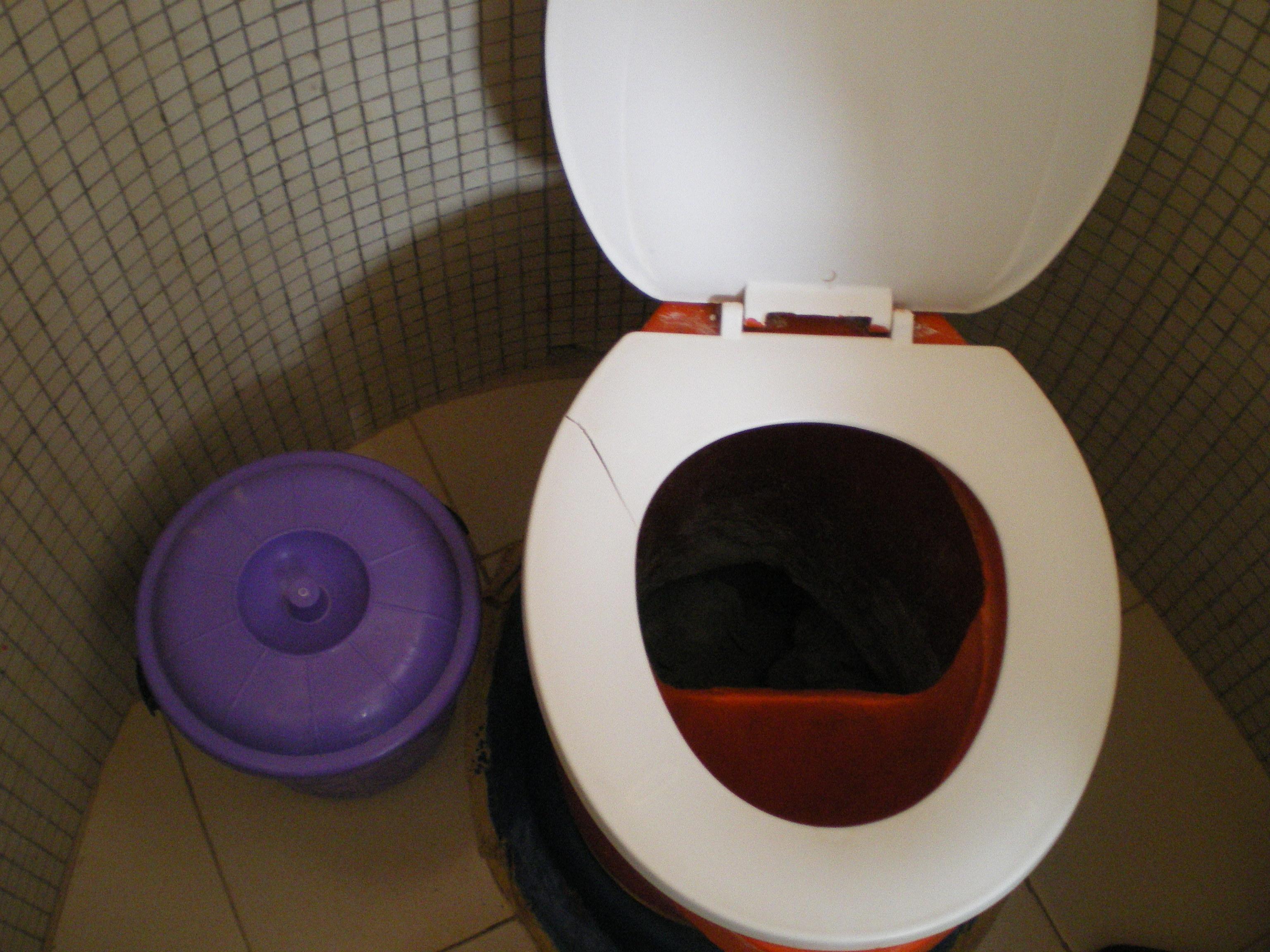 file urine diversion toilet bowl with a bucket of ash. Black Bedroom Furniture Sets. Home Design Ideas