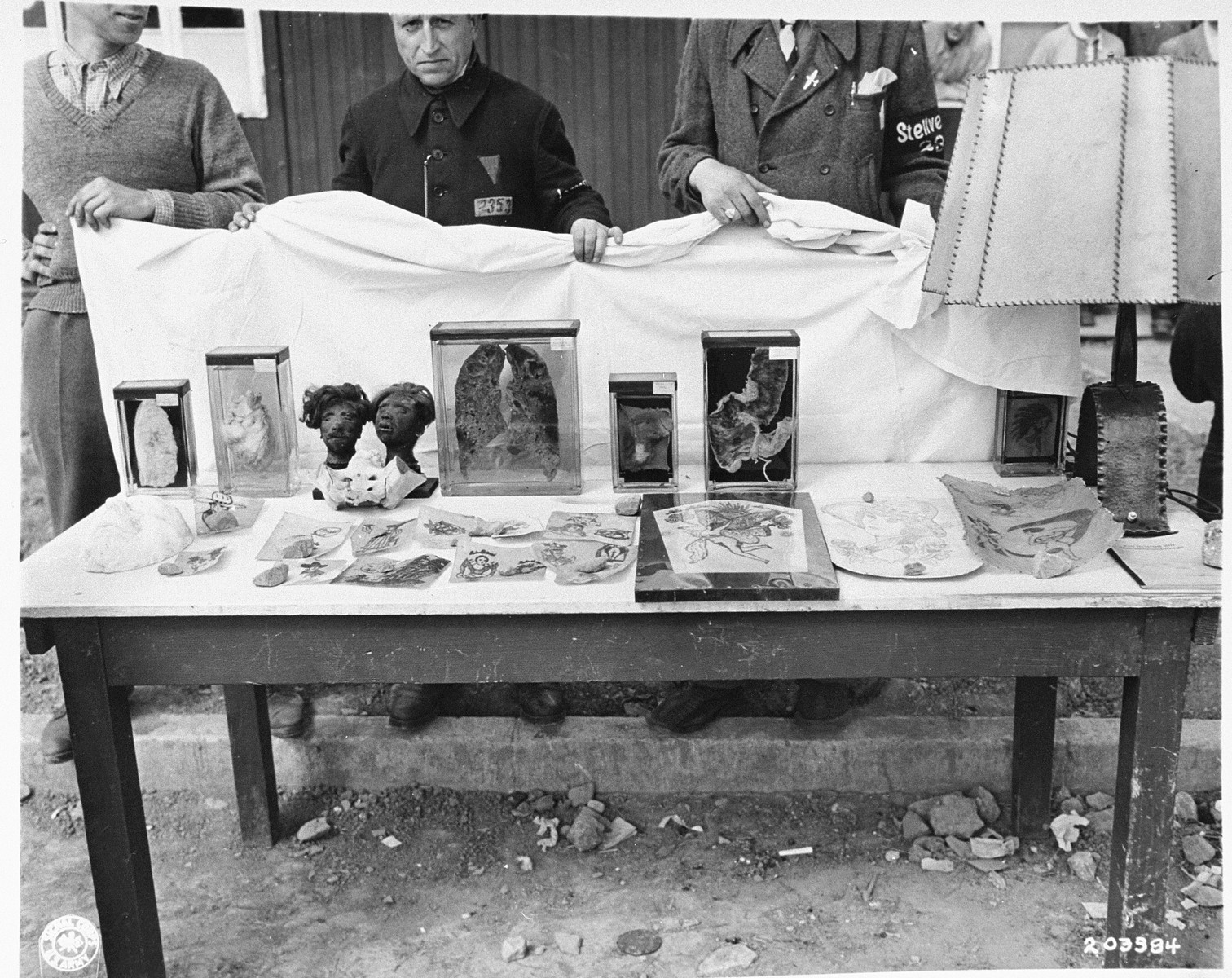 Buchenwald 16 April 1945. Collection of prisoners' internal organs including two human heads remains (upper left) and also examples of tattooed skins (foreground)