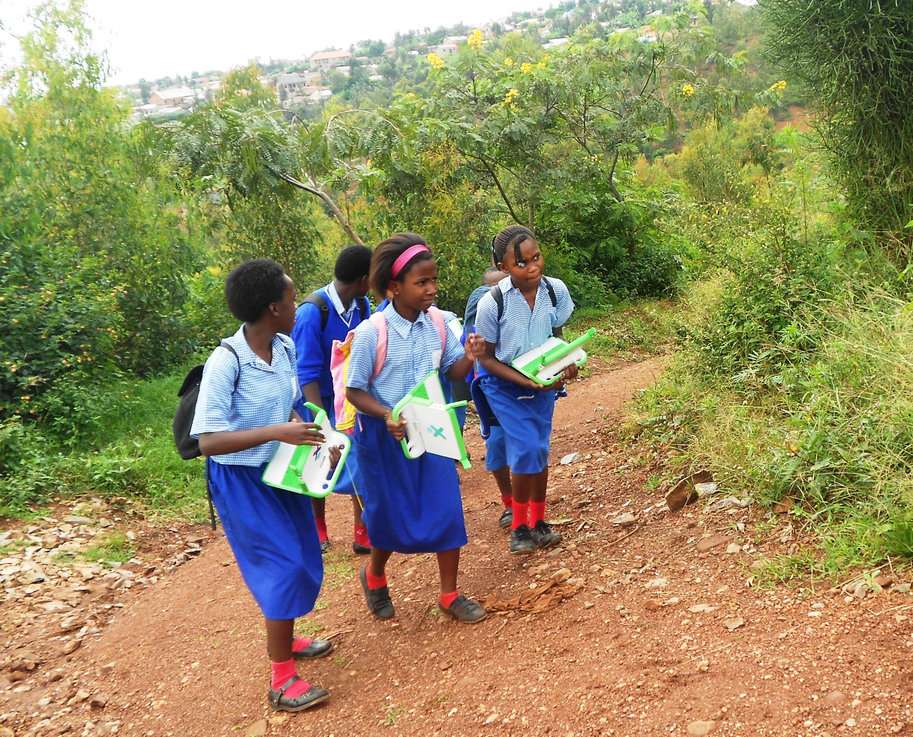 File:Children with OLPC laptops on the way home.jpg - Wikimedia ...