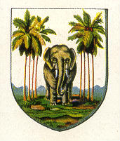 Shield shape with an elephant center and four palm trees on each side
