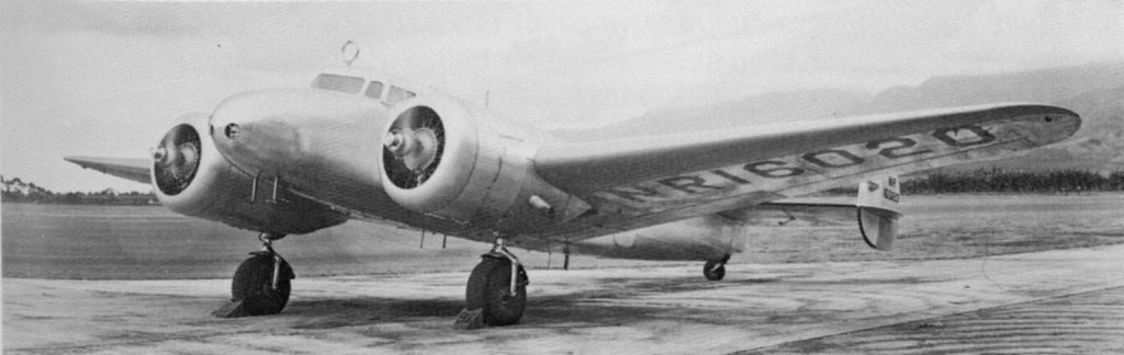 Amelia Earhart's Lockheed Electra 10E. During its modification, the aircraft had most of the cabin windows blanked out and had specially fitted fuselage fuel tanks. The round RDF loop antenna can be seen above the cockpit. This image was taken at Luke Field on March 20, 1937; the plane would crash later that morning.