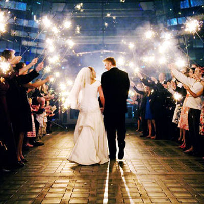 File:Guests holding large sparklers at a wedding.jpg