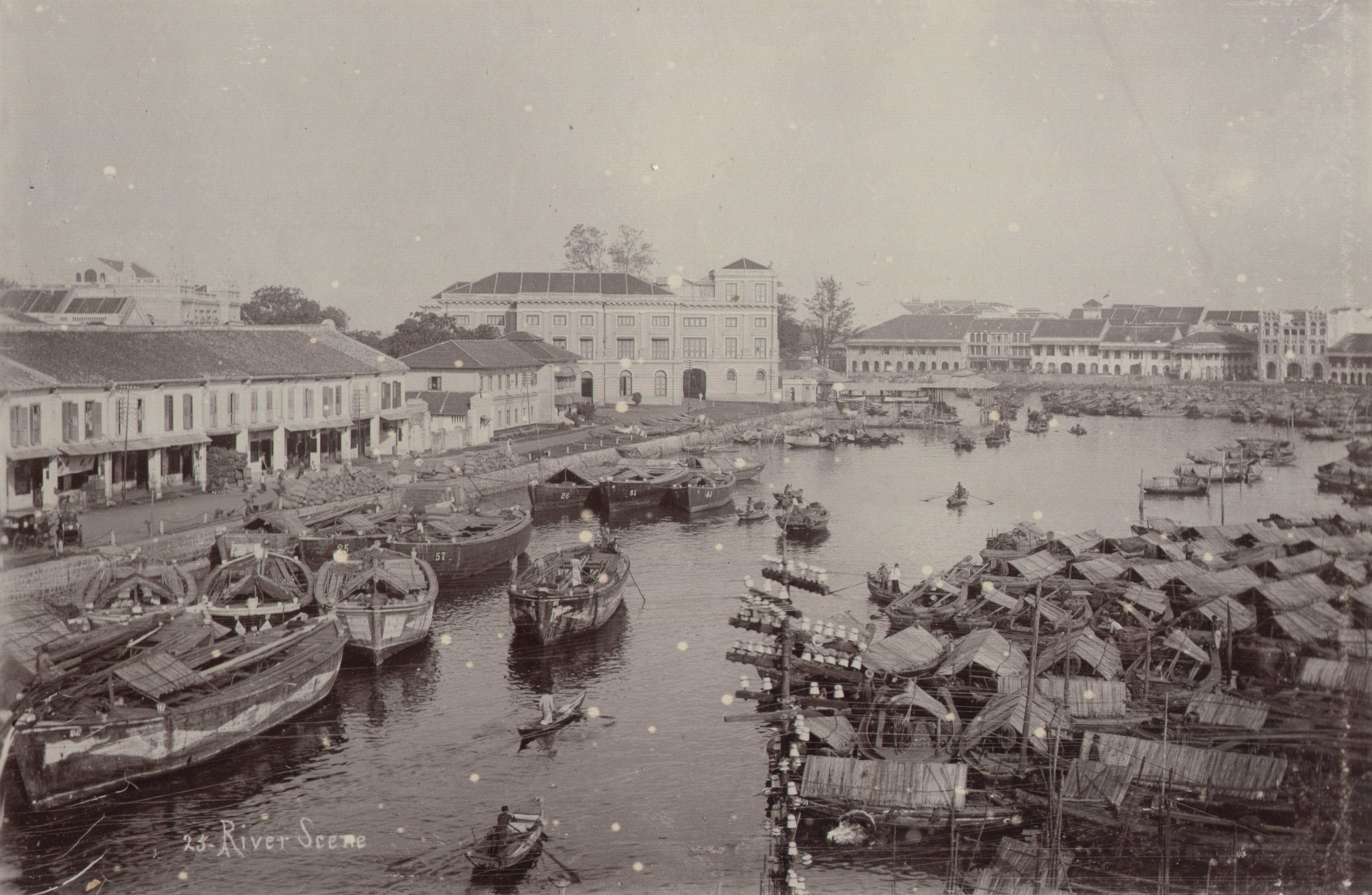 Sepia photo of boats tied in Singapore's port, circa 1900 CE
