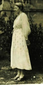 Photograph of Ka Cox standing in a dress, date unknown