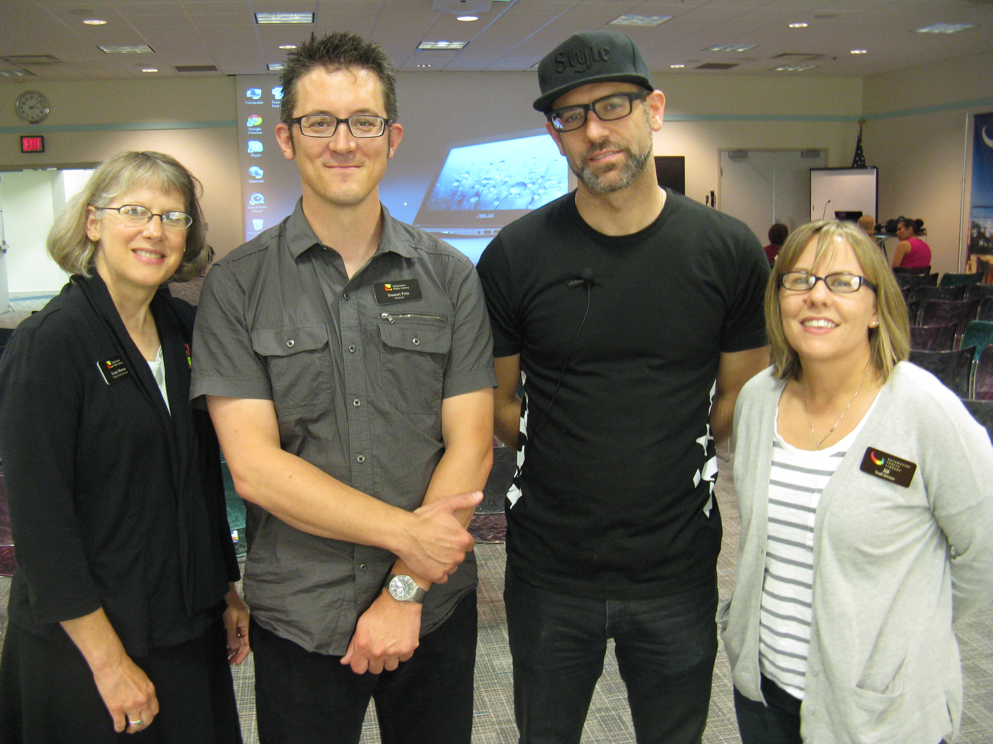 Kevin Coval (with cap) at the [[Kalamazoo Public Library