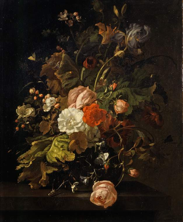 Flowers in a glass vase, on a stone table
