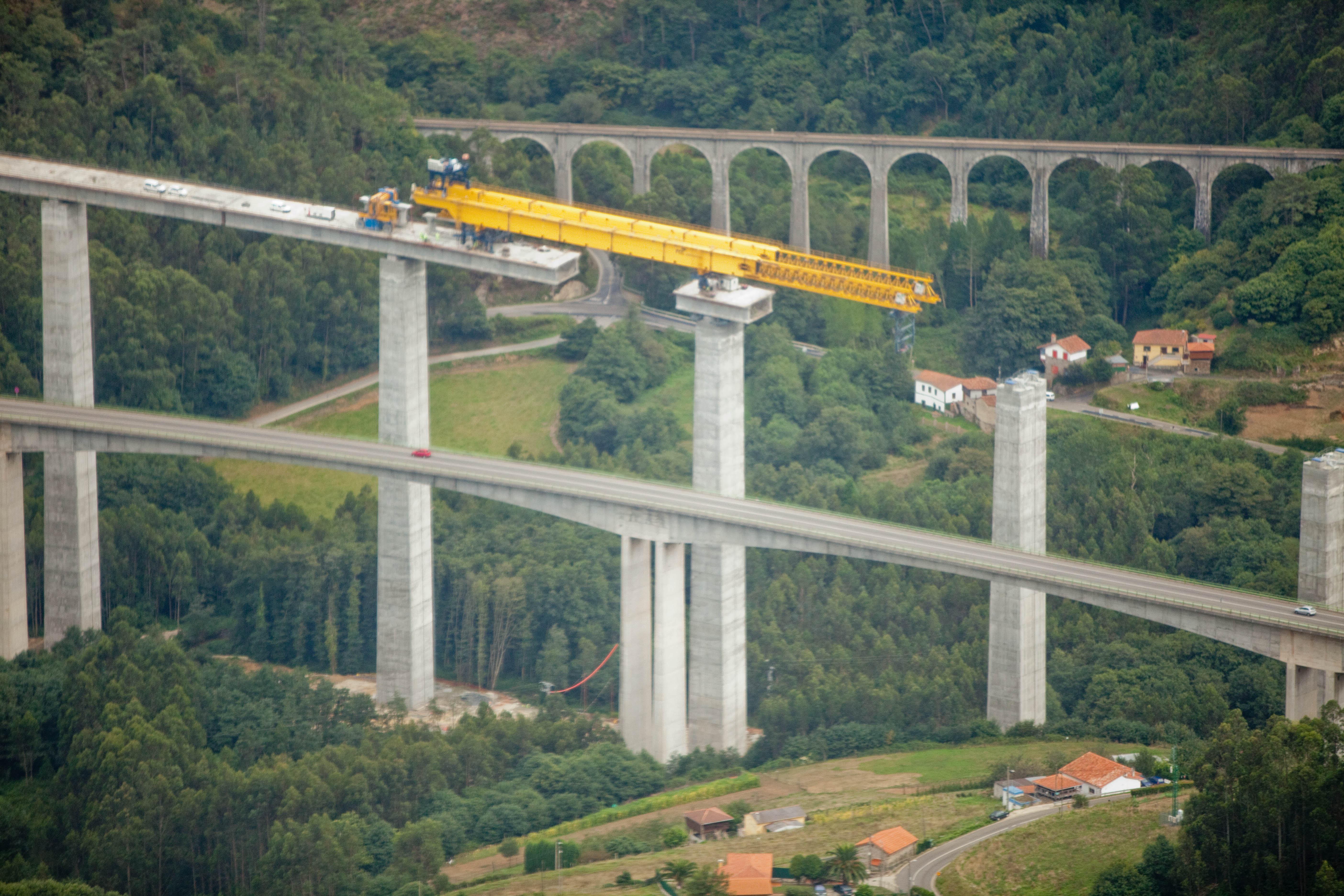 file building a bridge on the coastline near santander