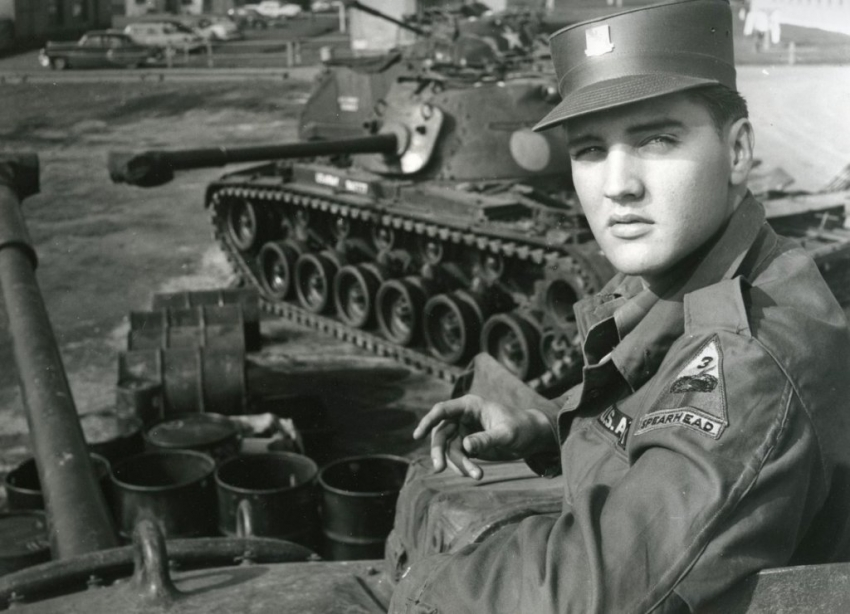 Elvis Presley poses for the camera during his military service at a US base in Germany.