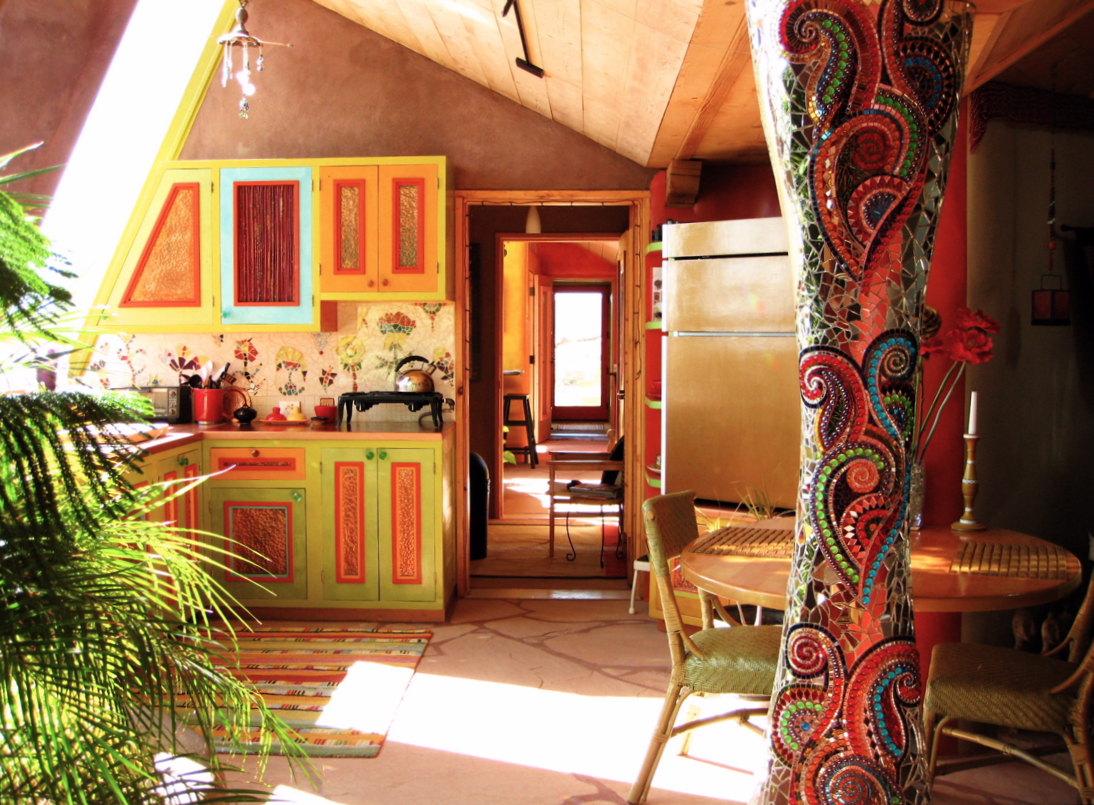 the interior of an earthship style home note the beautiful mosaic the interior of an earthship style home note the beautiful mosaic work on the