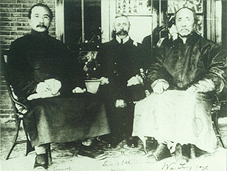 Tang Shaoyi, left. Edward Selby Little, middle. Wu Tingfang, right. Nanbeihetan 1911.png