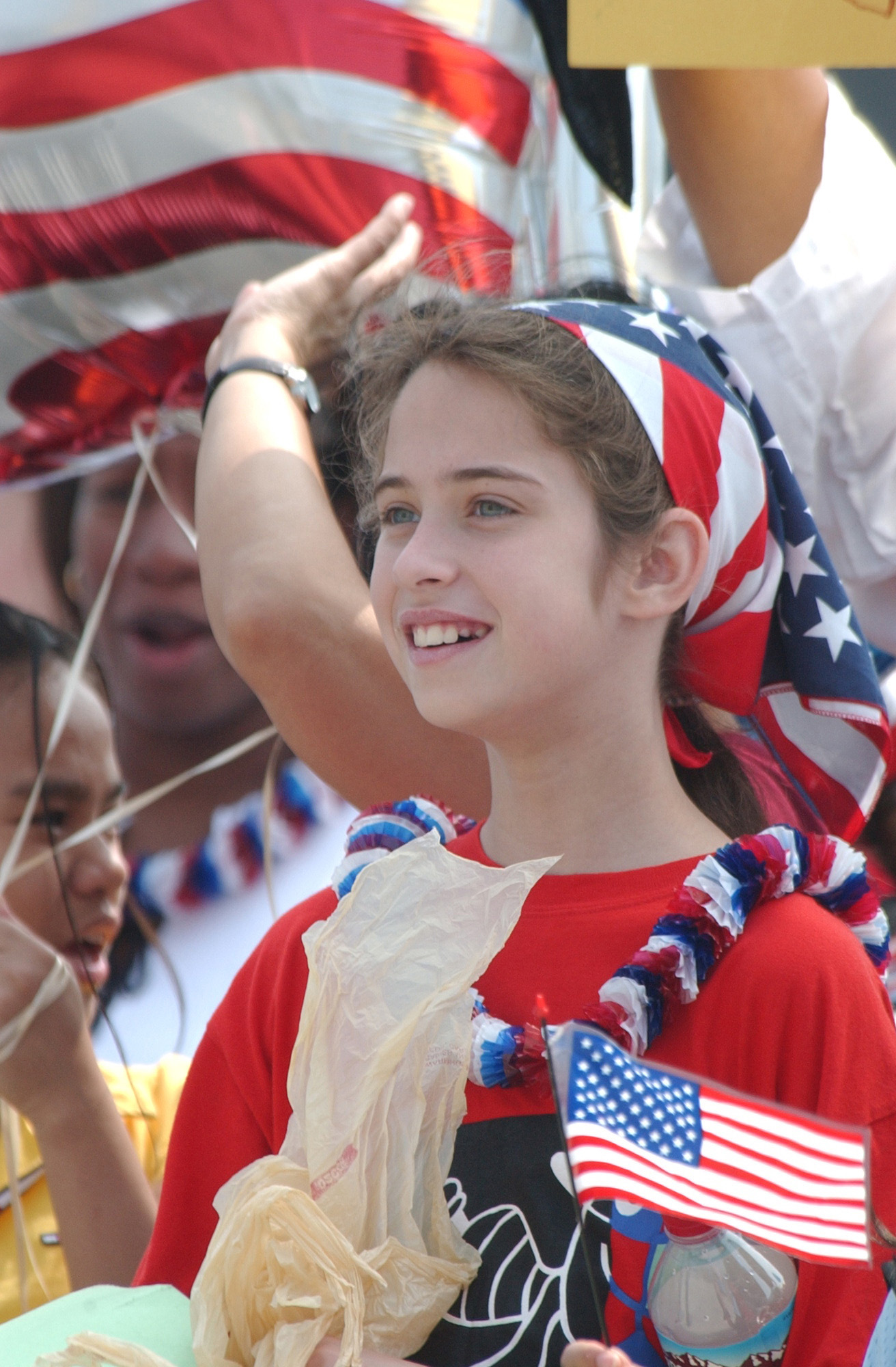 6811l 057 a young girl proudly wears the colors of the united states