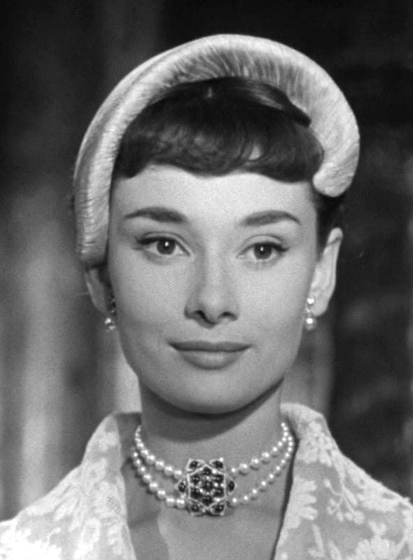 Audrey Hepburn with a disposable diaper on her head