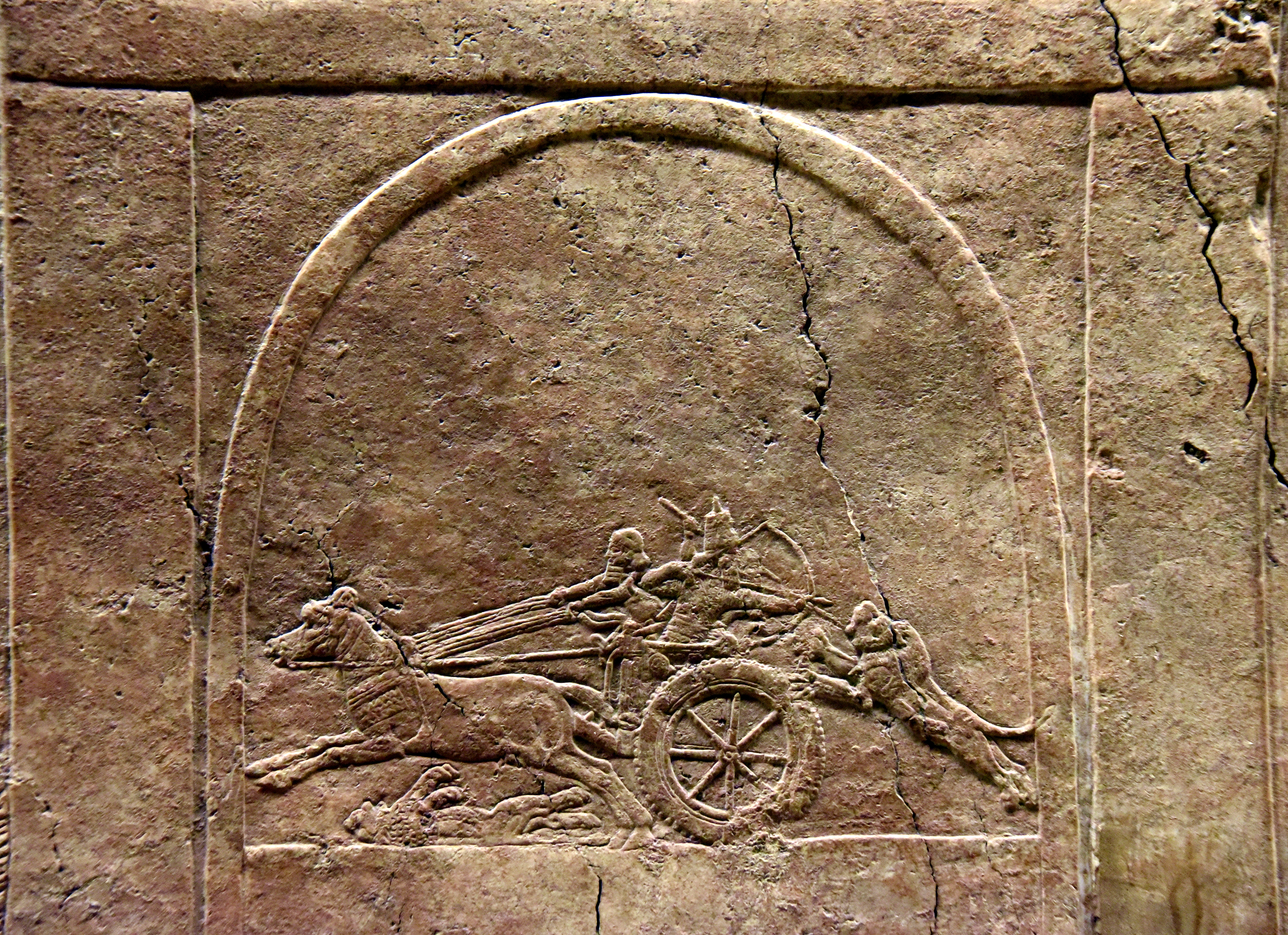 https://upload.wikimedia.org/wikipedia/commons/3/38/Detail,_depiction_of_a_stele_or_a_monument_of_lion-hunting_on_a_large_lion-hunt_gypsum_wall_slab._From_Ninevah,_Iraq._8th_century_BCE._British_Musuem.jpg