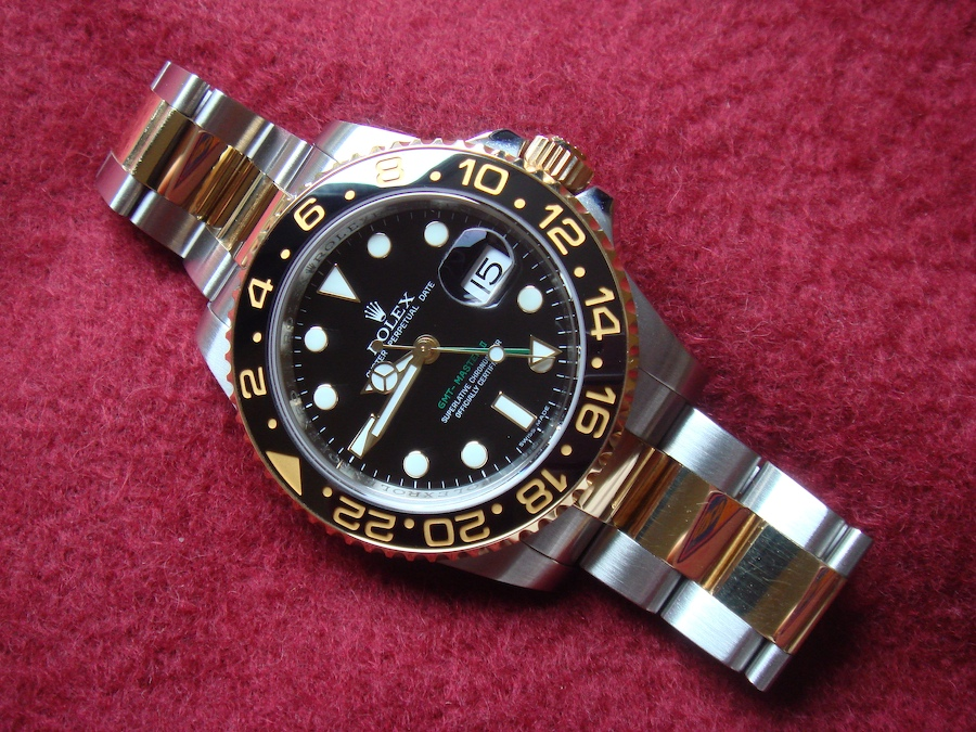 Rolex GMT Master II gold and stainless steel (ref. 116713LN)