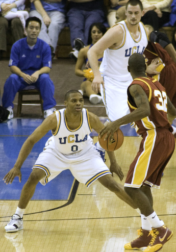 Russell Westbrook (left) and Kevin Love defend against USC Russell Westbrook guarding OJ Mayo cropped.jpg