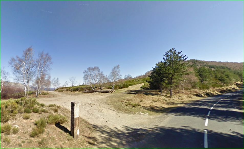 "Saint-Maurice-de-Ventalon territory, commune of Lozère department, region Languedoc-Roussillon. This is part of the Parc national des Cévennes.  Photo taken on the D35 road, coming from the  Croix de Berthel crossroads, showing the ""col de Chalsio""with the GRP «Tour de la haute vallée du Luech» hiking trail parallel to the road, here on the left; and the highest summit of Mount Ventalon (altitude 1128 m)."