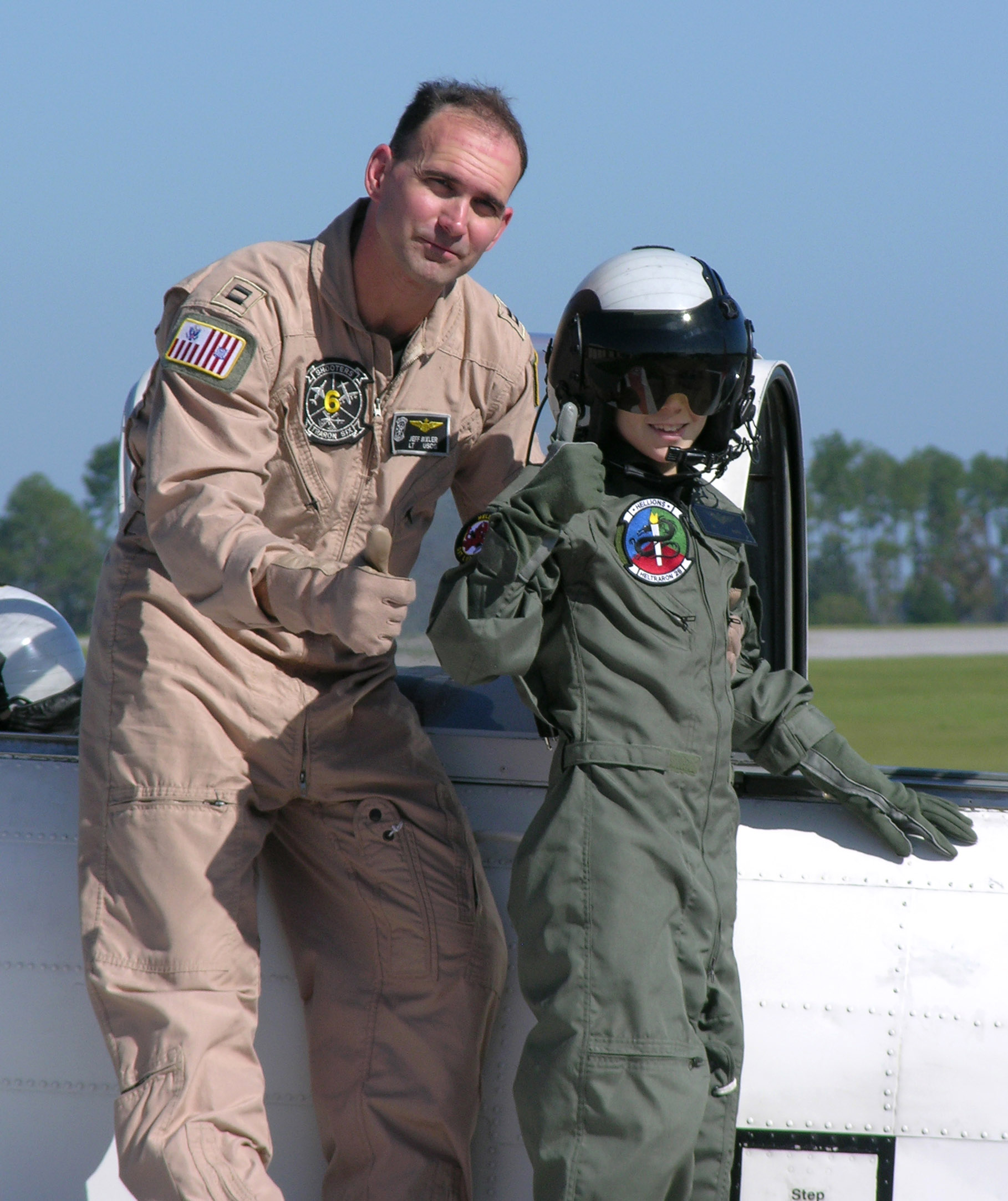 helicopter pilot uniform with File Us Navy 071002 N 1923s 002 Nicholas Mciver Gives A Thumbs Up With Lt Jeffrey Bixler  Vt 6 Instructor Pilot  After His First Taxi Ride In The T 34 At Naval Air Station Whiting Field on Whatever It Takes further V One Mens Cotton Pilot Shirt Short Sleeve Slim Fit P1160 furthermore Warrant Officer Candidate School Wocs further Uniformed Services University Alumnus Among Nasa S New Astronaut Class additionally Next Shooting.