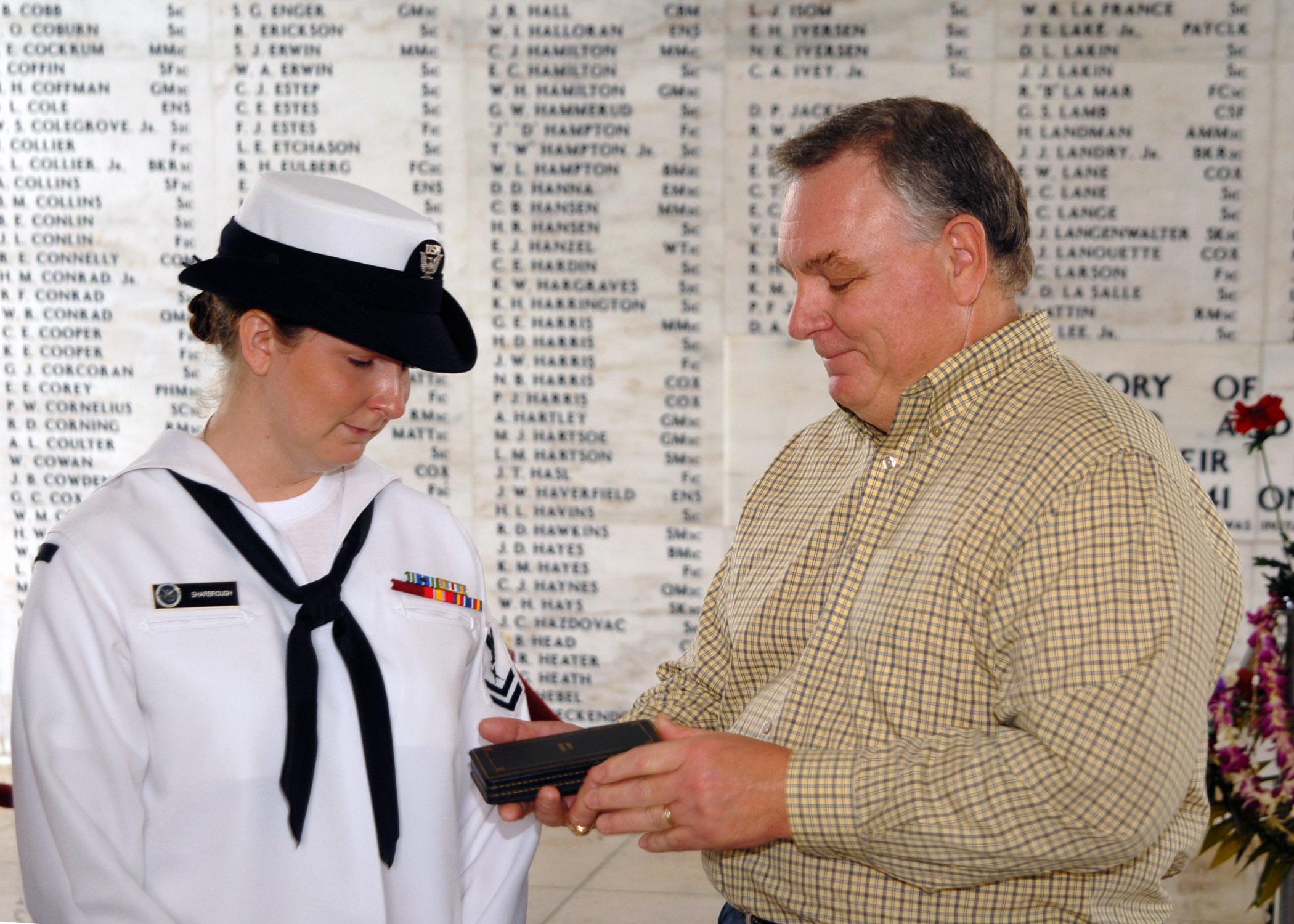 US Navy 071207-N-5476H-234 Tim Hodges presents his niece ...