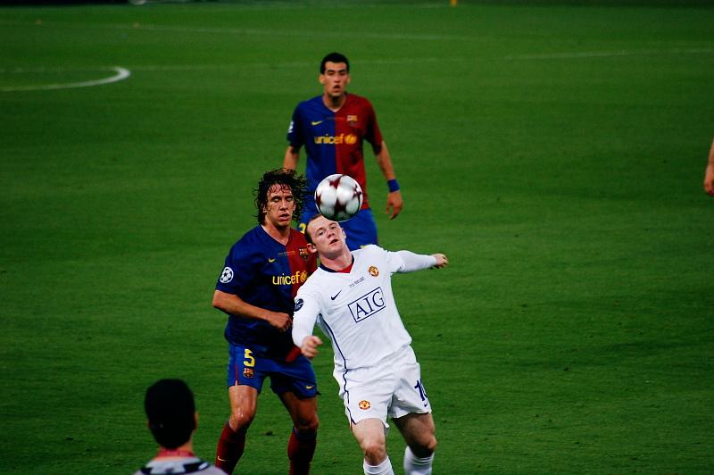 file wayne rooney vs carles puyol 2009 uefa champions league final jpg